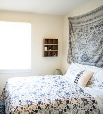 Decorated student's bedroom with college team flag and wall decorations